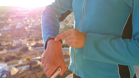 Sports woman using fitness tracker stock footage