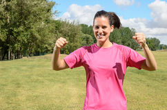 Sports Woman Win. Successful athlete woman celebrating victory with arms up outdoors Royalty Free Stock Photography