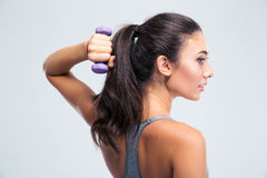 Sports woman working out with dumbbells Stock Photography