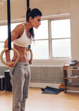 Sports woman working out with gymnastic ring Stock Photo