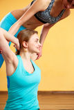 Sports women doing stretching exercises. In gym Stock Images