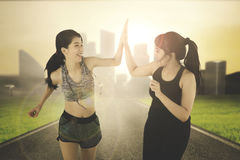 Sports women giving high five on street Royalty Free Stock Photo