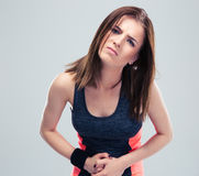 Sports women having pain in stomach Stock Photo