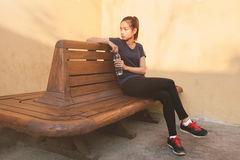 Sports women relax time and drinking water Royalty Free Stock Photos