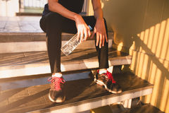 Sports women relax time and drinking water Stock Images