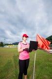 Sports women using laptop checking Royalty Free Stock Image