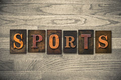 Sports Wooden Letterpress Theme. The word SPORTS theme written in vintage, ink stained, wooden letterpress type on a wood grained background Stock Photos