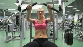 Beautiful blond girl engaged in the gym indoors stock footage
