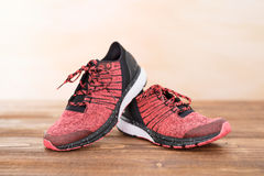 Sports workout shoes on wood floor Royalty Free Stock Image