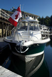 Sports yacht in Canada with Flag in beautiful suns. Hine Royalty Free Stock Photos