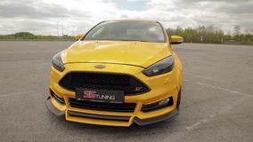 Sports yellow-orange car in the parking lot, low-profile tires. drag racing car, drifting car 07.05.2019 Ukraine Lviv. Sports yellow-orange car in the parking stock video footage