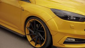 Sports yellow-orange car in the parking lot, low-profile tires. drag racing car, drifting car 07.05.2019 Ukraine Lviv. Sports yellow-orange car in the parking stock footage