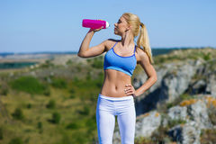 Sports and yoga girl drinking water Stock Photography