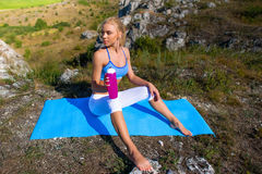 Sports and yoga girl drinking water Royalty Free Stock Photos