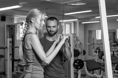 Sports young couple in the gym Stock Photos