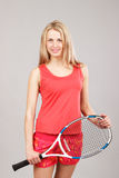 Sports young girl with a tennis racket Stock Images