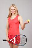 Sports young girl with a tennis racket Royalty Free Stock Image