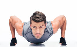 Sports young man doing push ups Royalty Free Stock Image