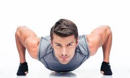 Sports young man doing push ups Royalty Free Stock Image
