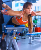 Sports young woman doing exercises on trainer back Royalty Free Stock Photography