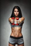 Sports young woman with dumbbells Royalty Free Stock Image