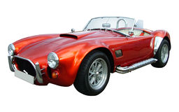 Sportscar AC Cobra. Red sportscar on a white background Stock Photos