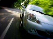 Sportscar che guida velocemente Fotografie Stock