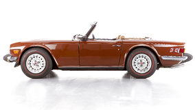 Sportscar convertible in brown  on white Royalty Free Stock Photos