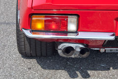 Sportscar exhaust. Sportscar twin polished chrome exhaust Stock Photo