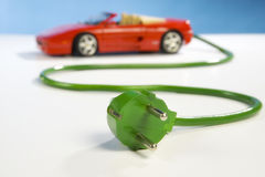 Sportscar and plug Royalty Free Stock Images