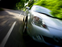 Sportscar que conduz rapidamente Fotos de Stock