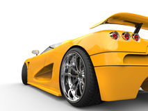 Sportscar - rear wheel closeup shot. Isolated on white background royalty free stock photography