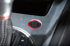 Sportscar's staart engine detail shot. A picture of a supercar's keyless start engine button Stock Photos