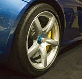 Sportscar wheel. Closeup of sportscar wheel and tire royalty free stock photo