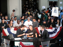Sportscasters interviews Hockey Player in front of crowd of fans Stock Photography