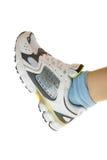 Sportschuh auf Frauenfahrwerkbein. Lizenzfreie Stockfotografie