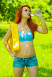 A sportsgirl drinking water Stock Image