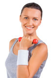 A sportsgirl holding weights isolated Royalty Free Stock Photo