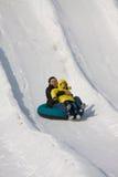 Sportslig snö och att ha gyckel Arkivfoton