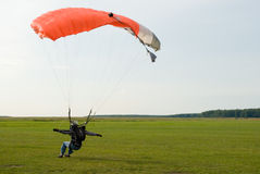 Sportsman. Landing of the sportsman after parachute jump Stock Photo