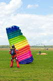 The sportsman. Puts a parachute after a jump Stock Image