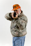 Sportsman. A hunter aiming his rifle Royalty Free Stock Photography