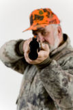 Sportsman. A hunter aiming his rifle stock photo
