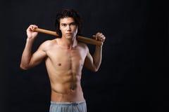Sportsman. Image of shirtless man with bat looking at camera Stock Photo