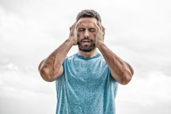 Sportsman with athletic body. coach in fitness gym. after workout. man athlete in blue sport tshirt. sportswear fashion royalty free stock images