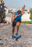 Sportsman. Athletic sportsman in sportswear training and running in city Royalty Free Stock Photos
