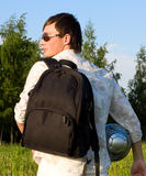 Sportsman with backpack and ball outdoor. Young sportsman with backpack and ball outdoor Royalty Free Stock Photo