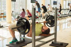 Sportsman with barbell. Stock Photos