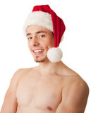 Sportsman with a bare torso and Santa hat Stock Photo
