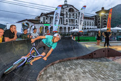Sportsman biker on outdoor pump track at Gorky Gorod mountain resort. Bike rider runs pursuit race. Sochi, Russia - July 11, 2015: Sportsman biker on outdoor Stock Photo